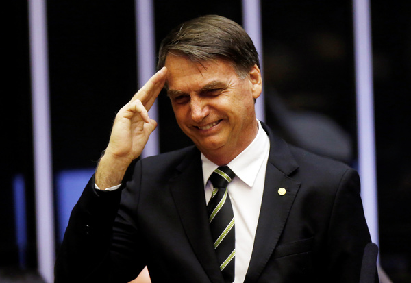 Brazilian President Jair Bolsonaro during a session of the National Congress in Brasilia. After 13 years of left-wing rule Brazil has voted for an extreme right-wing president. Bolsonaro won the elections with a 55.29% majority. REUTERS/Adriano Machado/Contrast