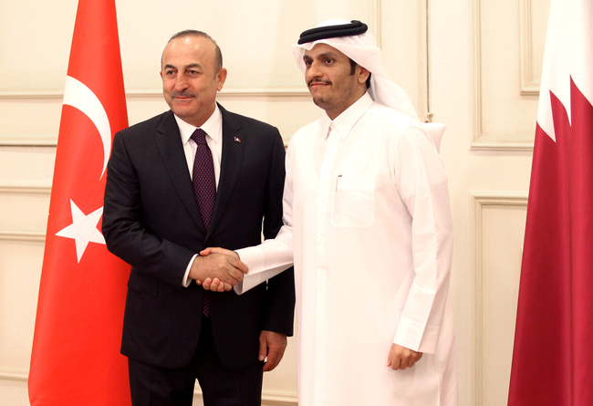 Qatar Foreign Minister Mohammed bin Abdulrahman bin Jassim al-Thani, with Turkish ForeignMinister Mevlut Cavusoglu during a meeting in Doha. REUTERS/Naseem Zeitoon/Contrast