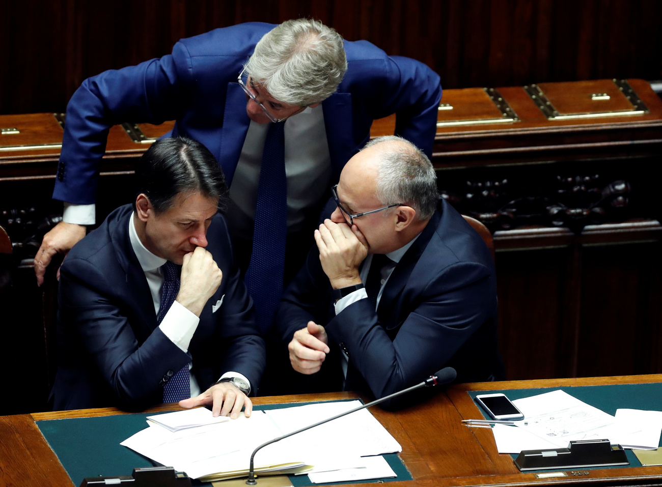 Italian Prime Minister Giuseppe Conte talks to Paolo Gentiloni and Economy Minister Roberto Gualtieri as they wait during a confidence vote at the Parliament in Rome, Italy, September 9, 2019. REUTERS/Remo Casilli