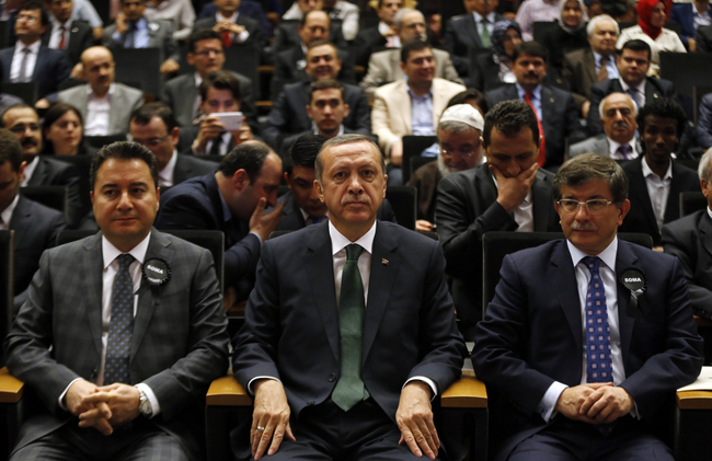 Erdogan with his former ministers Ali Babacan and Ahmet Davutoglu. REUTERS/Umit Bektas