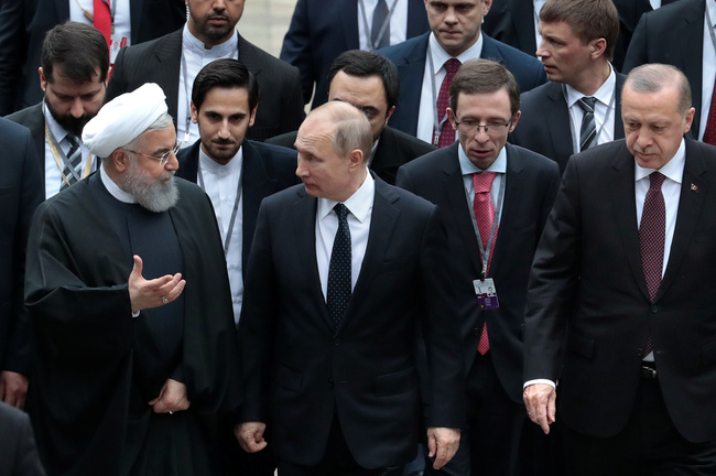 Iranian President Hassan Rouhani, Russian President Vladimir Putin and Turkish President Recep Tayyip Erdogan in Sochi during a meeting to promote the peace process in Syria. Sergei Chirikov/Pool via REUTERS