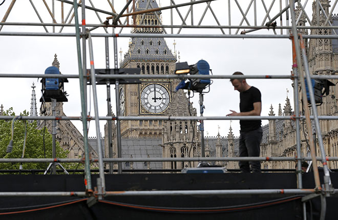 London, United KingdomA man works on a television platform being erected on College Green outside the Houses of Parliament in London May 5, 2015. Britain will go to the polls in a national election on May 7. REUTERS/Peter Nicholls