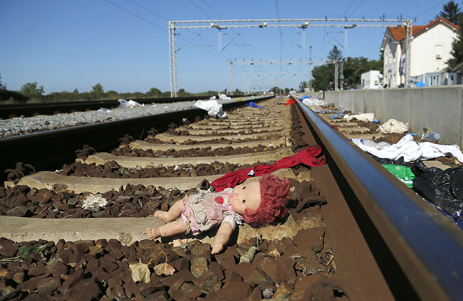 TOVARNIK, CroatiaAn abandoned doll lies on a rail track strewn with rubbish at the train station in Tovarnik, Croatia September 21, 2015. Croatia will demand that Greece stop moving migrants from the Middle East on to the rest of Europe, Interior Minister Ranko Ostojic said on Monday.