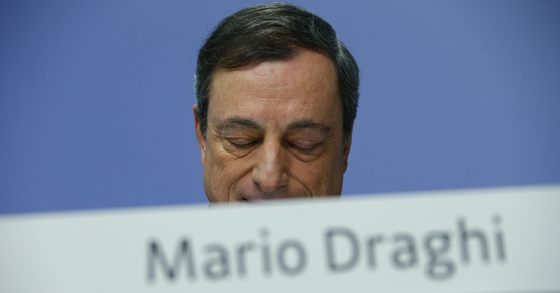 European Central Bank (ECB) President Mario Draghi looks down during an ECB news conference December 4, 2014, for the first time in the ECB's new 1.3 billion euro headquarters in Frankfurt. REUTERS/Ralph Orlowski