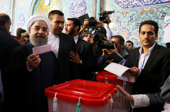 Rouhani casting his vote (Reuters)