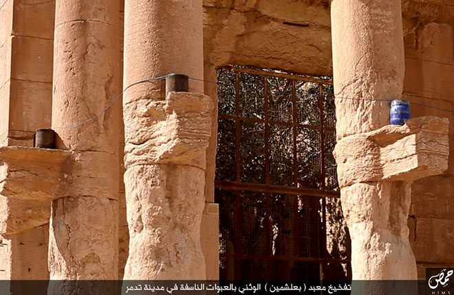 "Palmyra, SyriaAn image distributed by Islamic State militants on social media on August 25, 2015 purports to show explosives on stone ledges of columns during what they said was the destruction of a Roman-era temple in the ancient Syrian city of Palmyra. Syria's antiquities chief Maamoun Abdulkarim told Reuters the images did appear to show the destruction of the ancient Baal Shamin temple and correlated with descriptions given by residents of the explosion detonated there on Sunday. Five photos were distributed on social media showing explosives being carried inside, being planted around the walls of the temple, a large blast and then rubble. The arabic script seen along the bottom edge of the photograph reads ""Placing explosives in the Baal Shamin pagan temple in the city of Tadmour"". REUTERS/Social Media"