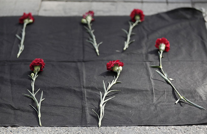 Istanbul, Turkey Carnations are seen placed on the ground during a protest against explosions at a peace march in Ankara, in central Istanbul, Turkey, October 10, 2015. At least 30 people were killed when twin explosions hit a rally of hundreds of pro-Kurdish and leftist activists outside Ankara's main train station on Saturday in what the government described as a terrorist attack, weeks ahead of an election. REUTERS/Osman Orsal