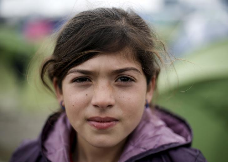 Salma, a 10-year-old Iraqi girl of the Yazidi faith, poses for a picture at a makeshift camp for refugees and migrants at the Greek-Macedonian border, near the village of Idomeni, Greece March 17, 2016. REUTERS/Alkis Konstantinidis