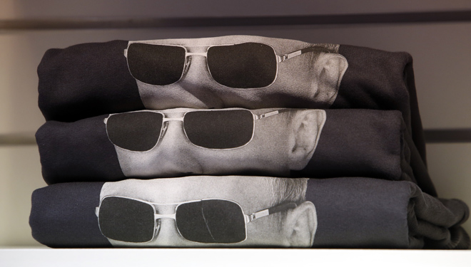 Moscow, Russia Sweatshirts bearing an image of Russia's President Vladimir Putin wearing sunglasses are displayed on a rack at GUM department store in central Moscow, October 7, 2014. Putin marks his 62nd birthday on Tuesday. REUTERS/Sergei Karpukhin
