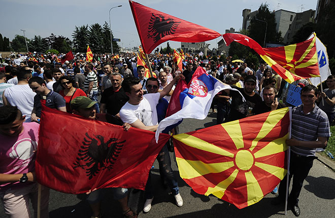 Skopje, MacedoniaProtesters wave Albanian, Macedonian and Serbian flags during an anti-government demonstration in Skopje, Macedonia, May 17, 2015. Thousands of anti-government protesters rallied in Macedonia on Sunday, demanding Prime Minister Nikola Gruevski resign over wire-tap revelations that have plunged the Balkan country into its worst political crisis since flirting with civil war in 2001. REUTERS/Ognen Teofilovski