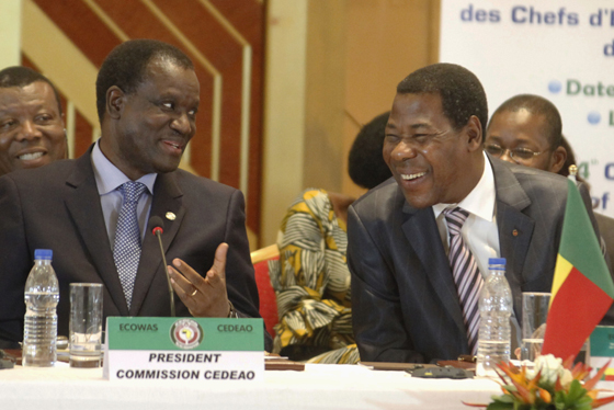 President of the Committee of ECOWAS Kadre Desire Ouedraogo (L) speaks with Benin's President Thomas Boni Yayi (R) during the 44th Ordinary Summit of heads of state and governments of the Economic Community Of West African States (ECOWAS) at Felix Houphouet Boigni Fondation in Yamoussoukro March 29, 2014. REUTERS/Thierry Gouegnon