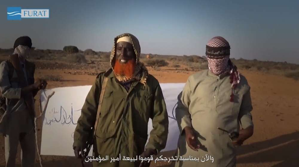 Abdulqadr Mumim, center, with red beard. Image from an Islamic State video showing a training camp in Puntland.