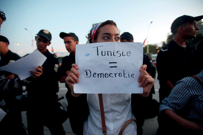 A demonstrator in Tunis during the Arab Spring. Today, six years after the 2011 protests, the challenge facing new Prime Minister Youssef Chahed is how to stamp out rampant corruption.