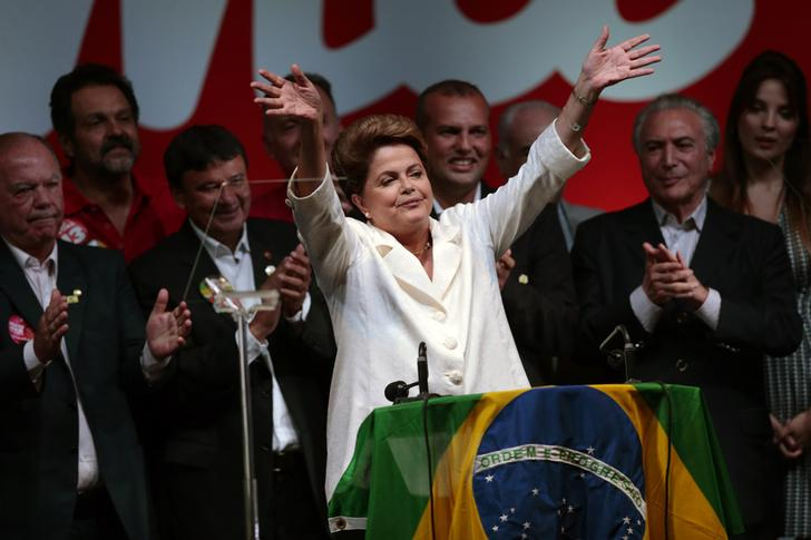Dilma Roussef in a 2014 photo celebrating the electoral results that decreed her re-election as president. On 31 August 2016 she was removed from office following impeachment procedures.