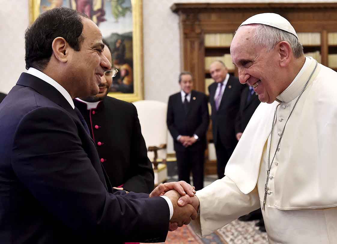 Pope Francis and Egypt's President Abdel Fattah al-Sisi shake hands during a private audience at the Vatican November 24, 2014. REUTERS/Gabriel Bouys