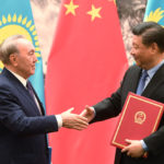 Kazakh President Nursultan Nazarbayev shaking hands with Chinese President Xi Jinping. Greg Baker/Pool via REUTERS/Contrast