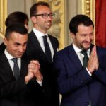 Italy's Minister of Labor and Industry Luigi Di Maio gestures next to Interior Minister Matteo Salvini after the sworn-in ceremony at the Quirinal palace in Rome, Italy, June 1, 2018. REUTERS/Remo Casilli