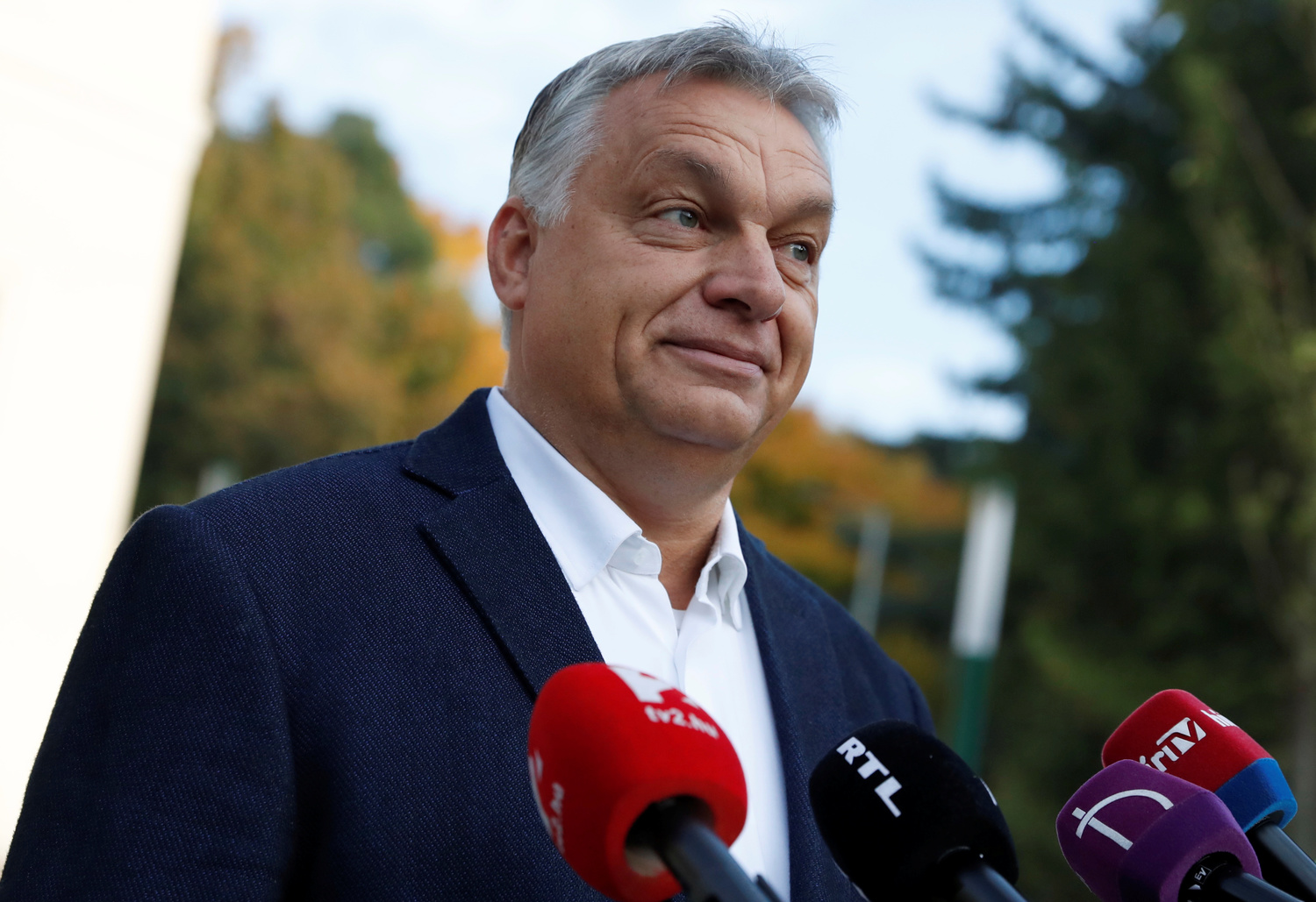 Hungarian Prime Minister Viktor Orban talks to the media after casting his ballot during Hungary's local elections in Budapest, Hungary, October 13, 2019. REUTERS/Bernadett Szabo